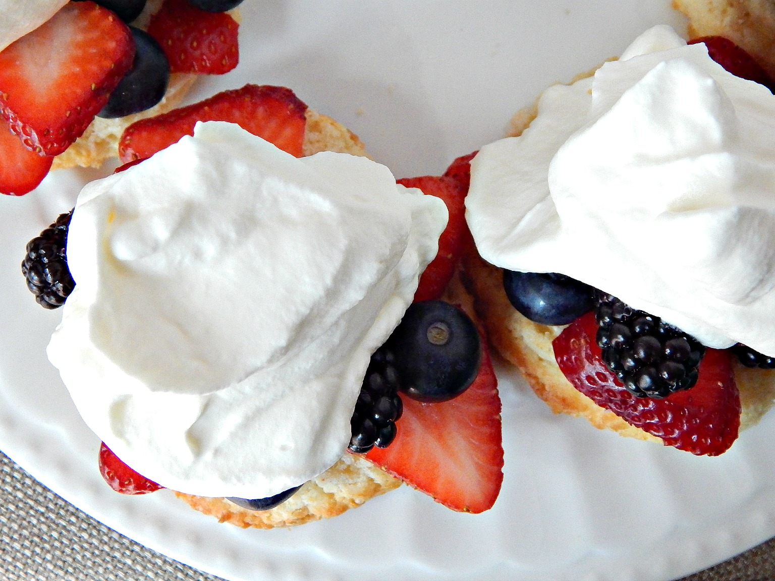 Bursting Berry Shortcakes Strawberries Blackberries Blueberries Whipped Cream Shortcakes on Sugar Bananas