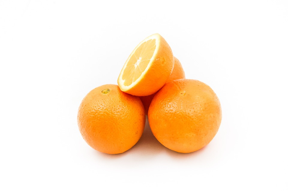 fresh oranges on a white background