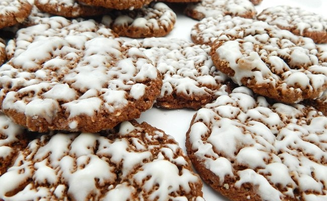 Plateful of iced oatmeal cookies on www.sugarbananas.com