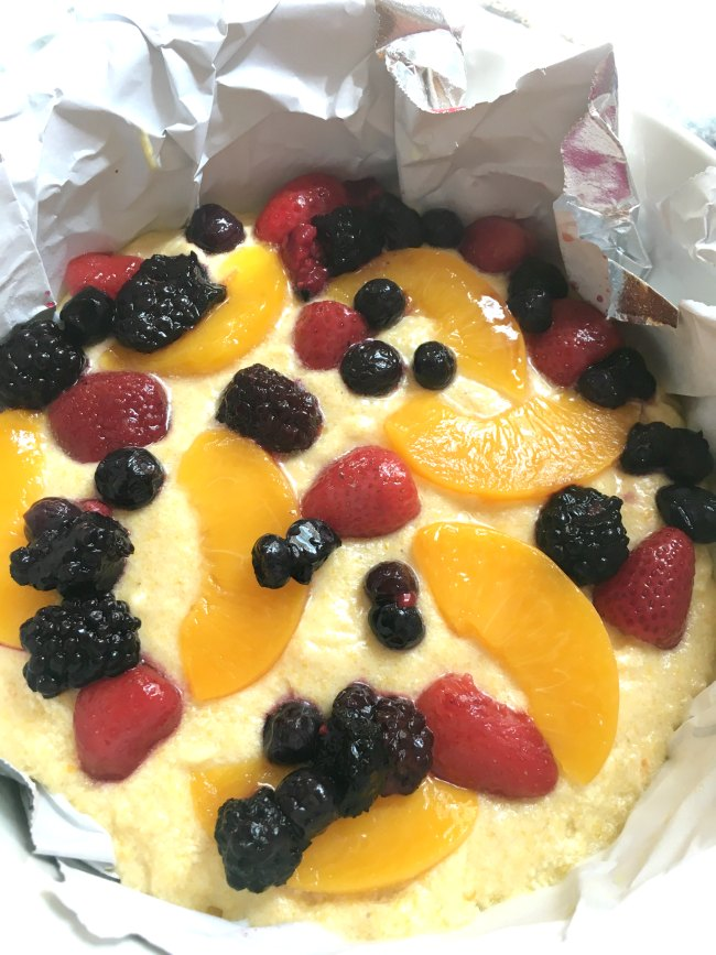 Peach Berry Cornmeal Sheet Cake Batter Topped With Peaches and Berries on www.sugarbananas.com